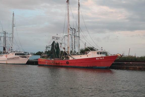 Red Shrimp boat docked in the Louisiana marsh