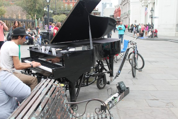 "Tons of good music from the street musicians but the pianist brought the biggest amp. Note the bicycle hitch. I am sure there were naysayers to the ""I bet I can bicycle this baby"" idea."