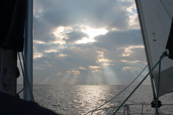 Sun poking through the clouds as we motored down Shell Island Cut and into the Gulf