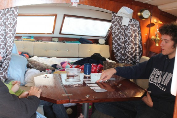 Randall, Lily and Jake playing five card draw while Tammy is at the helm.