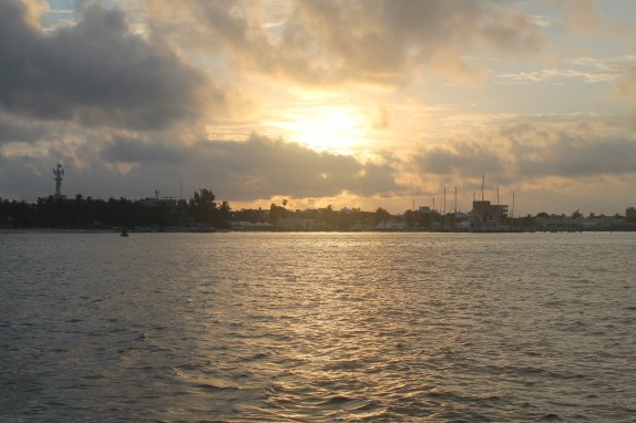 Sunrise peeking through clouds over Isla Mujeres