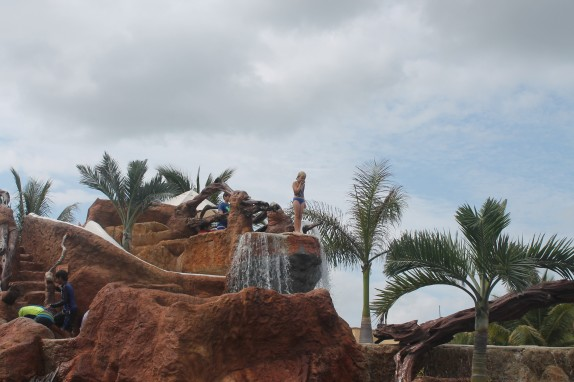 Lily on the pool's cliff diving platform