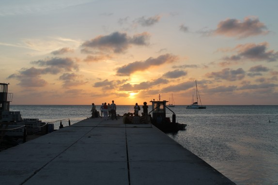 Sunset gathering on pier - Cay Caulker