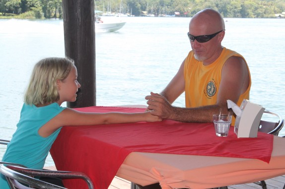 Randall and Lily at a table at Backpackers on Rio Dulce.