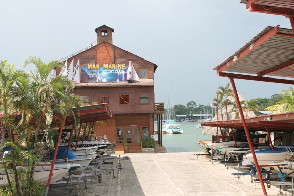 Streetside view of Mar Marina. This three story building is old brick and wood with a watch tower on top. Lily thinks the security guards man the watchtower at night.