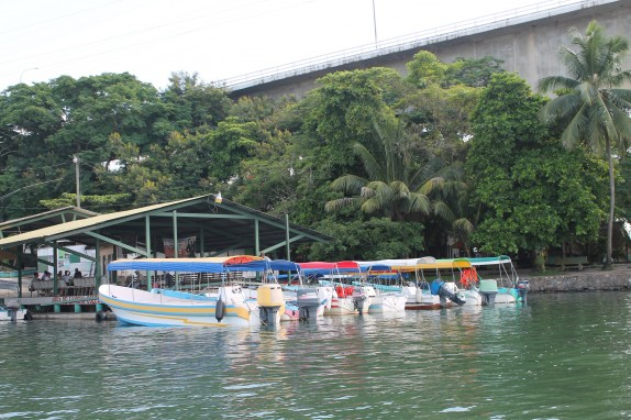 Lanchas lined up under the Rio Dulce bridge. This is the favored mode of transportation.