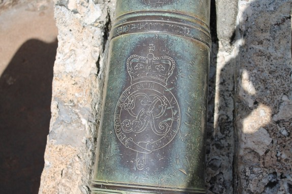 Close up on cannon insignia.
