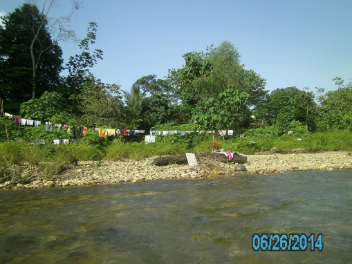 Some of the villagers were at the river doing laundry.