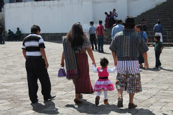 Churchgoers were seen in both traditional Mayan clothing and modern attire.