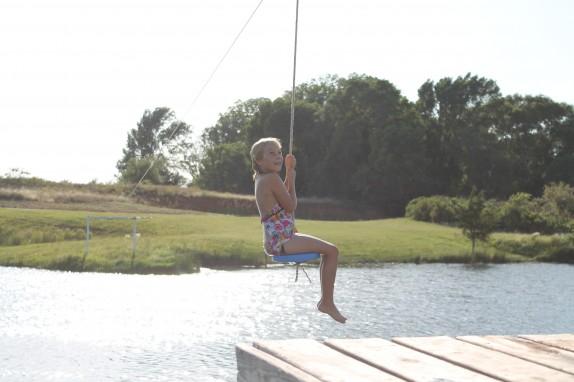Ziplining into the pond.