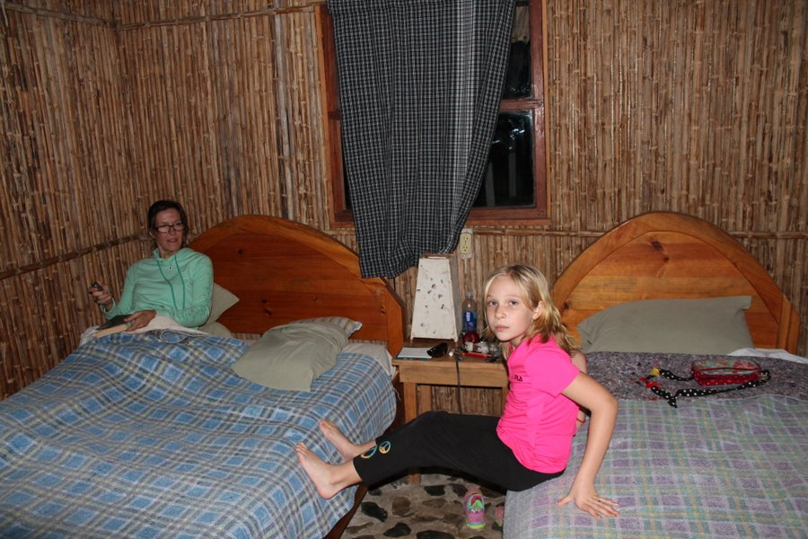 Our little room with cane walls and river rock flooring. I don't know what is in my hand but it is for-sure not a remote.