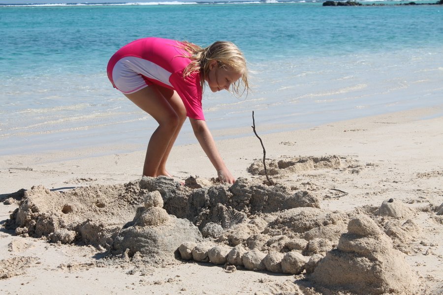 Sand castle city had a central lagoon where a small conch was entrapped and played with between construction projects.