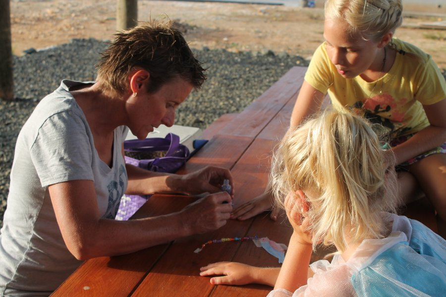 Tracy glamming up Molly and Lily's fingernails with glitter polish.