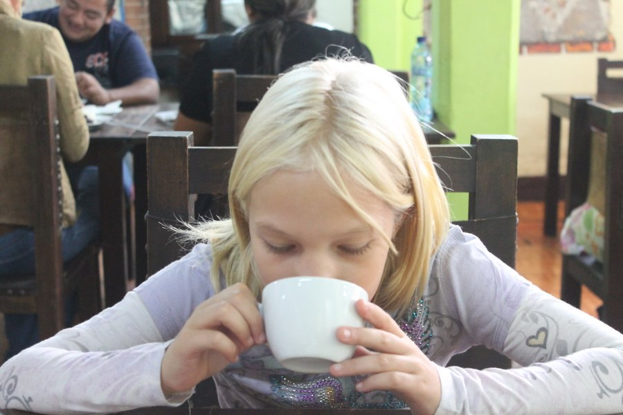 Lily having cafe con leche.