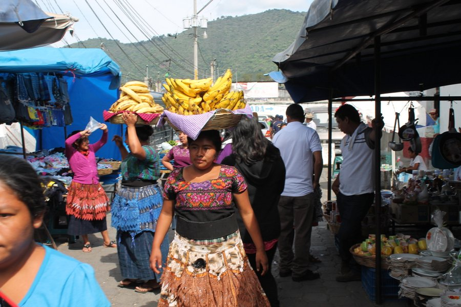 Lots of Mayan ladies with their colorful skirts walk the busy streets with fruit- for-sale.
