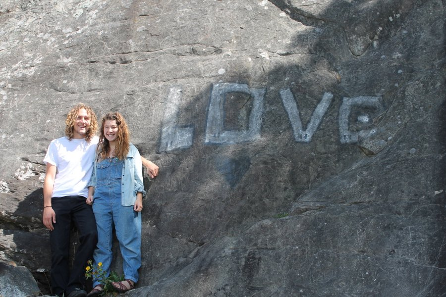 "Posing beside ""LOVE"" graffiti. My idea. They didn't protest."
