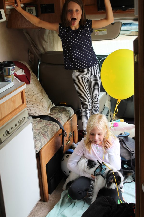 Girls playing with Arrow in the RV. I was trying to get a shot of the chaos of all our stuff thrown it but just could not quite get the effect.