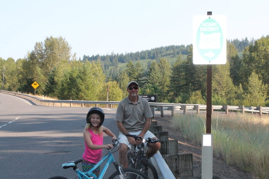 Randall and Lily at a biking trailhead south of Estacada on the Clackamas River. We made it only a mile on this trail before the heat got to us. We thought there would be places to get in the river but it was too overgrown along this section.