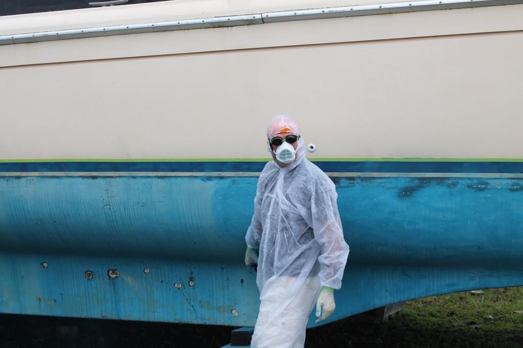 Randall sanding Foxtrot's bottom paint