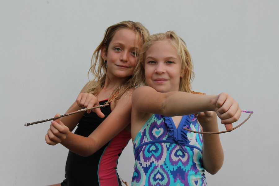 Fern and Lily taking aim at me with their homemade bows.