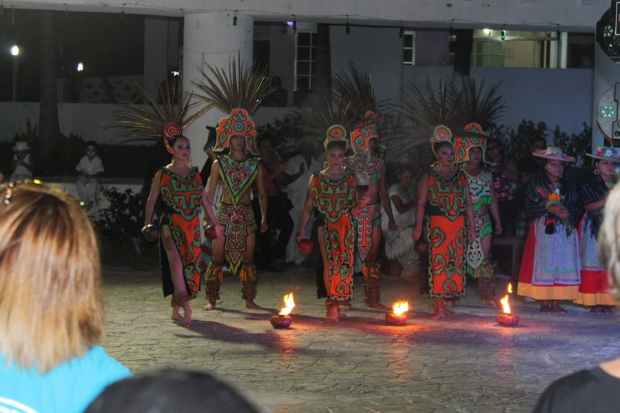 Dancers in Mayan costumes performing a really cool dance with lots of graceful kicks and jumps.