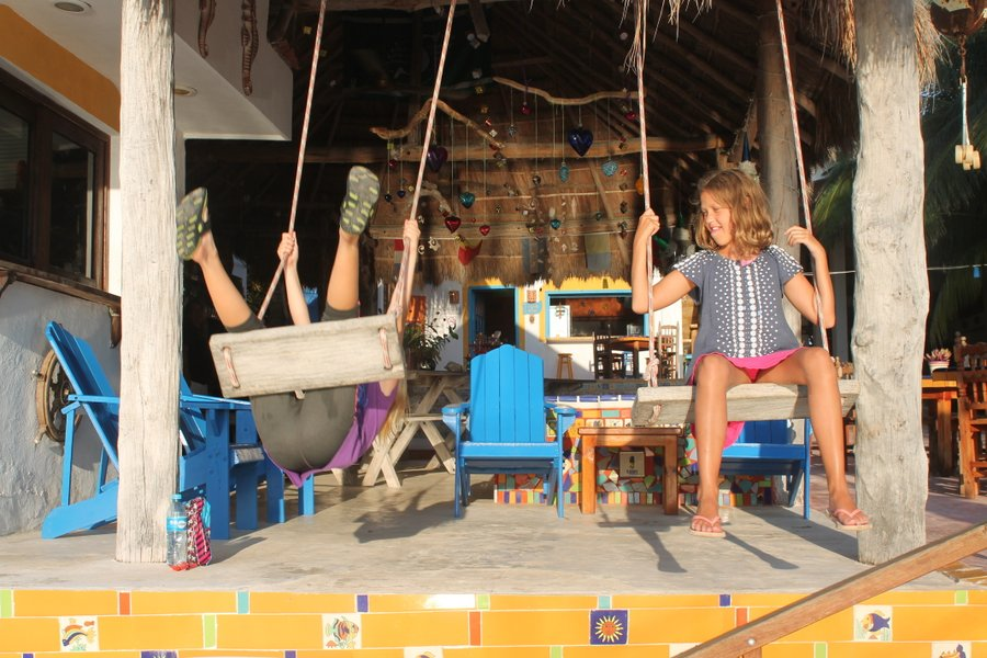 Lily and Christina swinging under the El Milagro palapa.