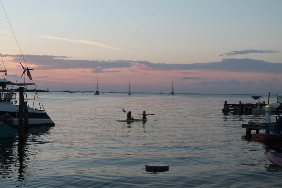 Christina and Lily kayaking at sunset.