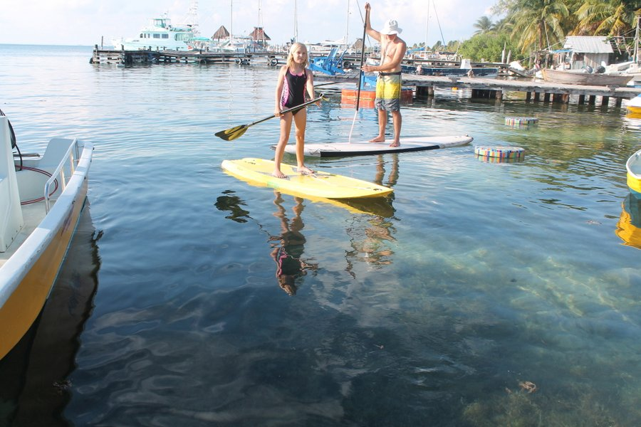 Lily jumps on one of the El Milagro paddle boards almost every day.