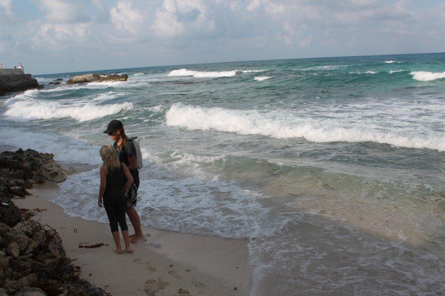 Sea glass hunting near Isla's malecon.
