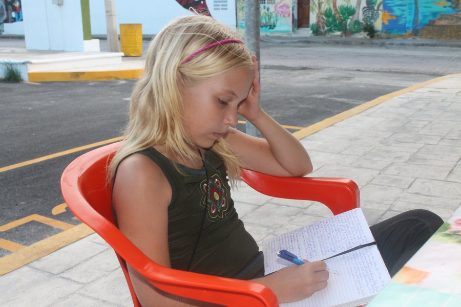 Lily drawing while we wait for lunch at a street vendor. We have fun trying to hunt out the best street food vendor.