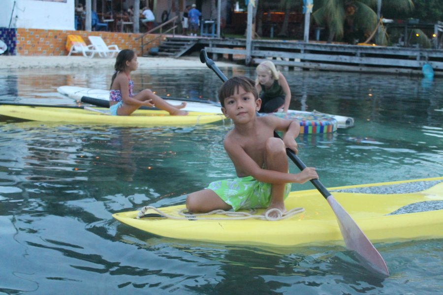 "Sebastian paddling around. The girls are tied up to their ""dock"" - the El Milagro swim-up table out in the water."