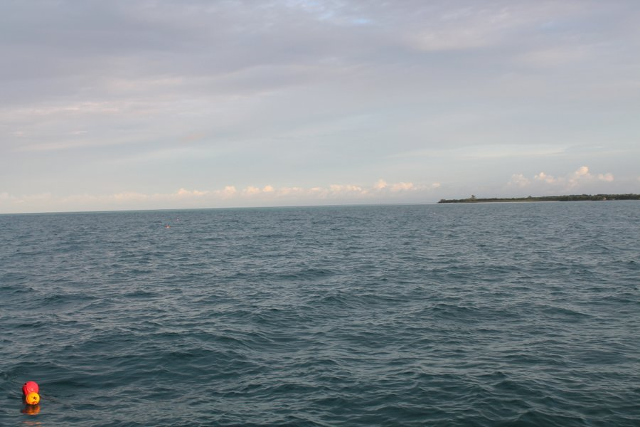 Leaving the anchorage at Boca Grande with a crab pot visible in the corner.
