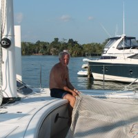 Our boat neighbor, Michel, patching up a net.